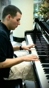 FDM Consultant Marcus Wichael plays the piano.