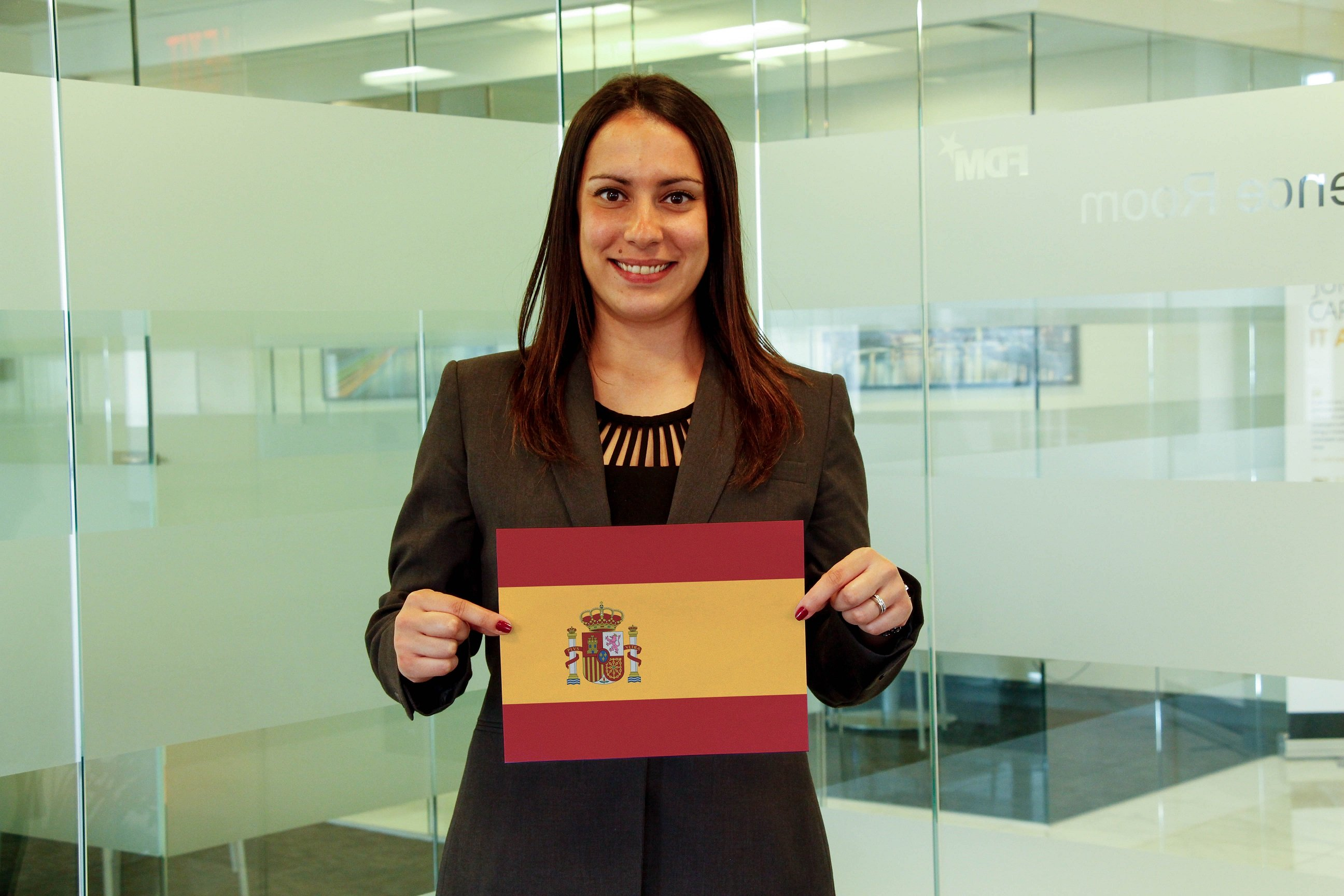 f.d.m. global marketing director Nabila Aydin holding a picture of the Spanish flag