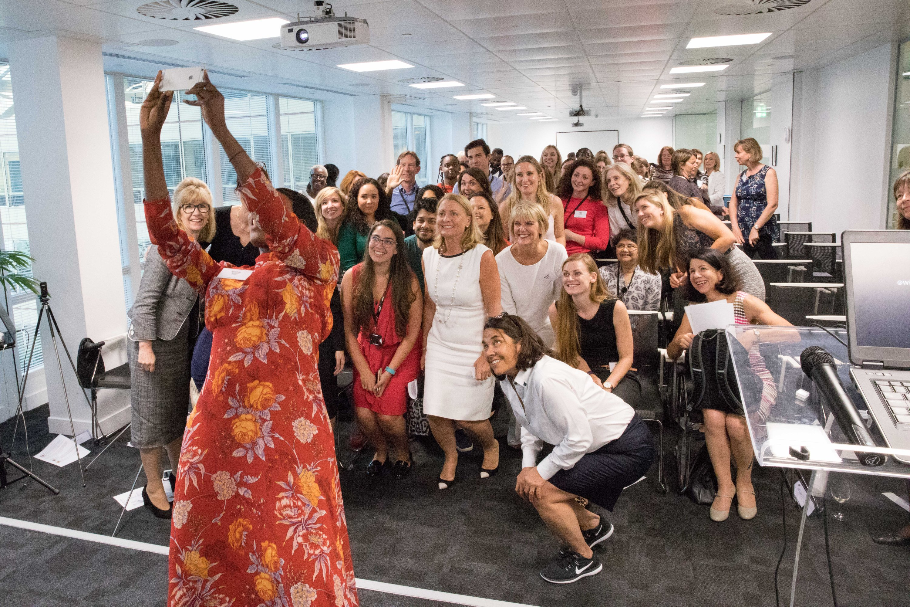 A large group of women in IT and telecoms posing for a group selfie
