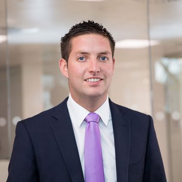 f.d.m. Ireland Account Manager Padraig Haughney in a dark suit against a blurred glass office background