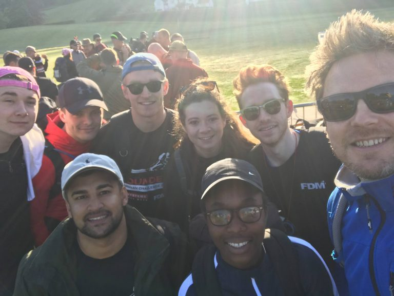 f.d.m. colleagues posing for a group selfie during the walking with the wounded charity walk