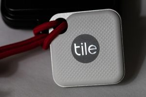 "a square device with ""tile"" written in the centre."