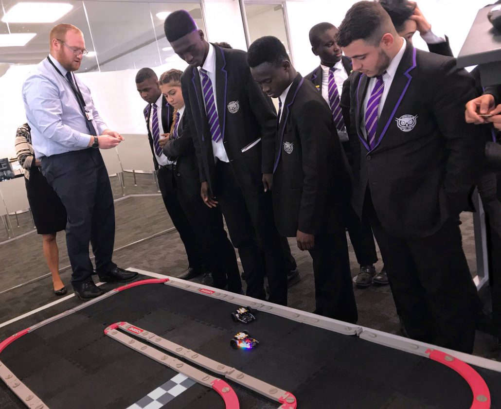 Colleagues from F.D.M. Leeds and school boys operating radio controled robots as part of a UK wide school's engagement programme