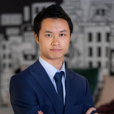 f.d.m. hong kong Consultant Jason Cheung in a dark blue business suit with his arms folded