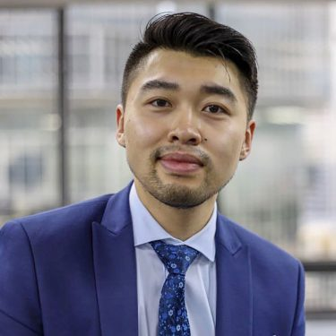 f.d.m china assistant project manager Max Zhong in a light blue suit