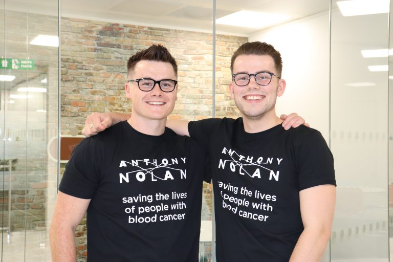 two male f.d.m. colleagues wearing anthony nolan charity t-shirts