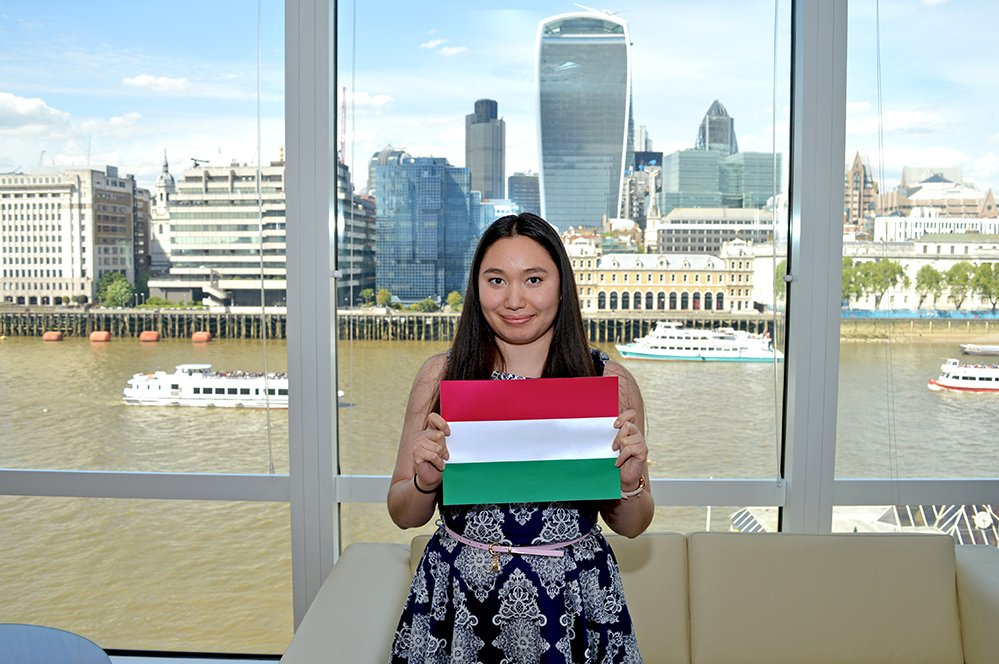 F.D.M. consultant Sherilyn Tran holding a picture of the Hungarian flag