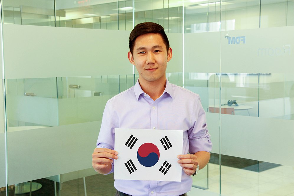 f.d.m. consultant Suhnyong Lee holding a picture of the Korean flag