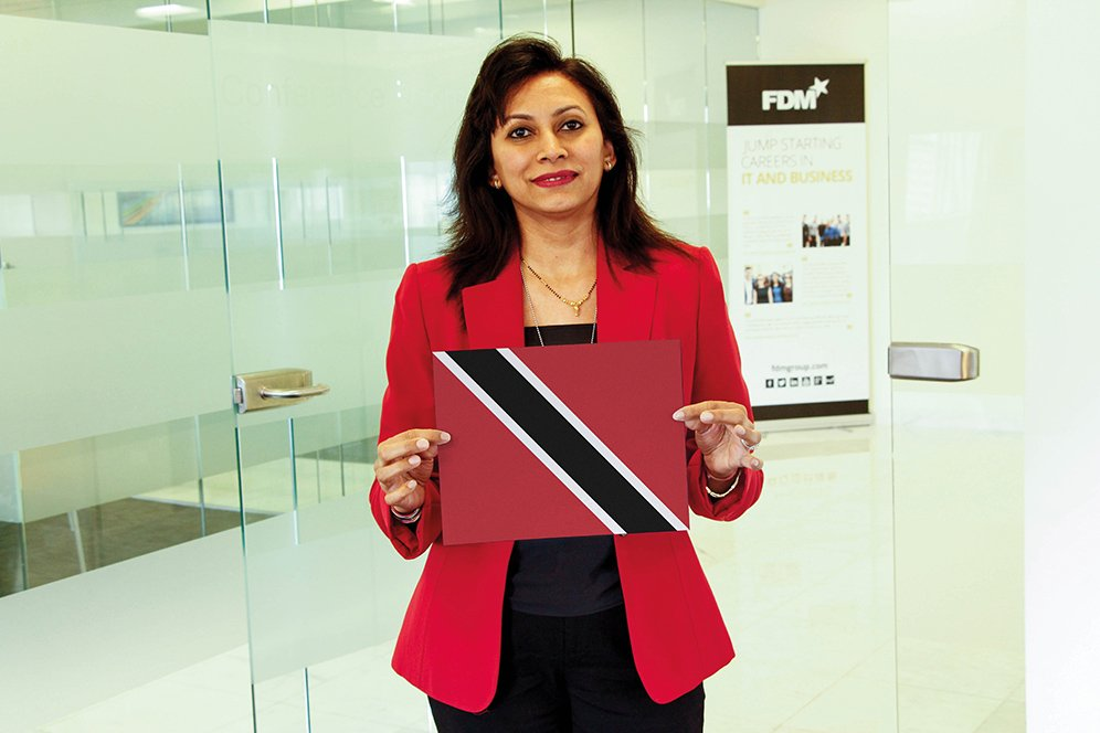 f.d.m. java software trainer Vijayanti holding a picture of the Trinidadian flag