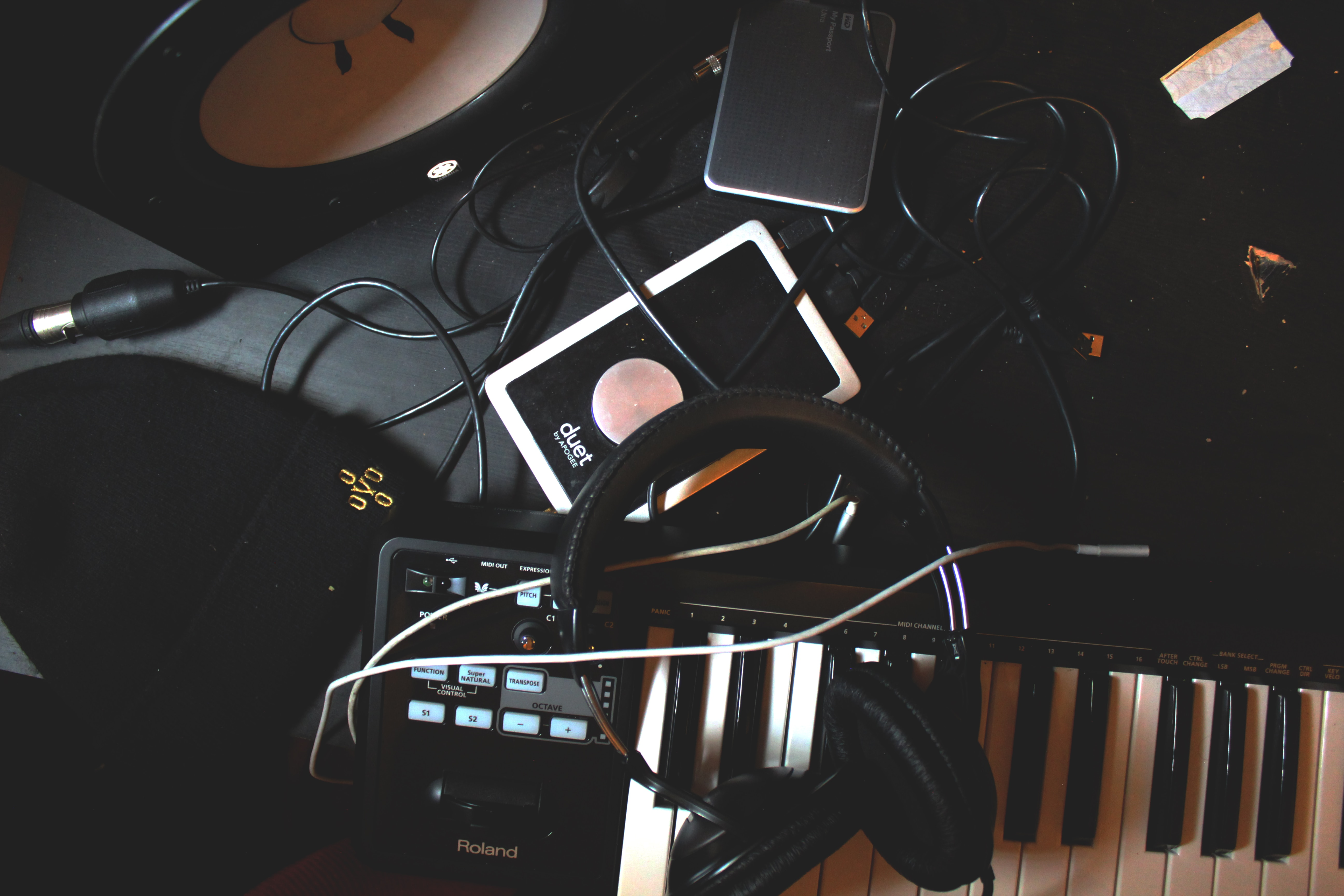 An array of musical products and cables piled messily on a table.