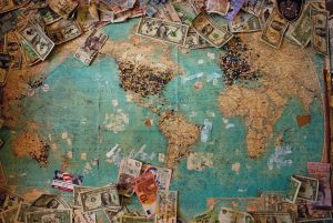 Map of the world surrounded with different currencies