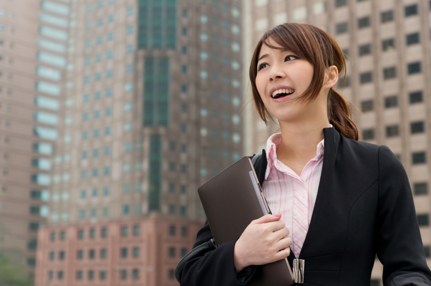 Young attractive businesswoman holding pad