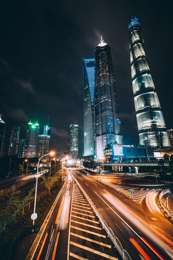 an image of the Shanghai Tower and World Financial Center at night